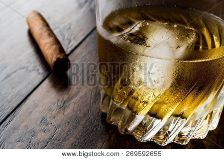 Godfather Cocktail With Cigar On Dark Wooden Surface