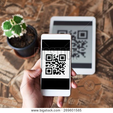 Qr Code Payment Transaction Using Mobile Smartphone And Tablet Devices. Scanning Qr Code From The Ta