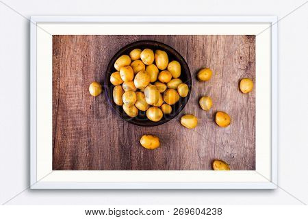 Potatoes In A Rustic Plate. Raw New Potato. Fresh Natural Vegetables. Organic Bio Food On Wooden Tab