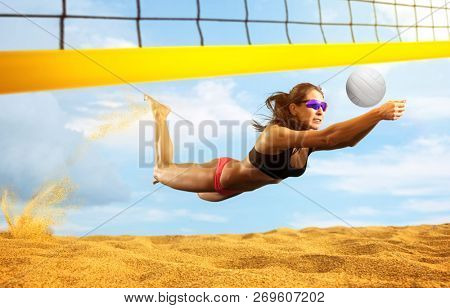 Female volleyball beach  player in action
