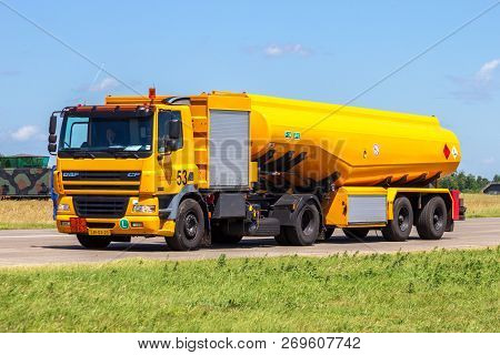 Volkel, The Netherlands - Jun 15, 2013: Mobile Kerosine Refueling Vehicle Driving On The Taxi Track