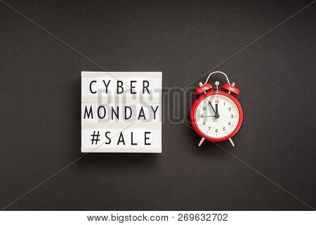Creative Top View Flat Lay Promotion Composition Cyber Monday Sale Text On Lightbox Alarm Clock Whit