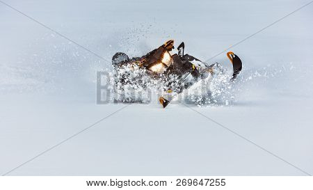 In Deep Snowdrift Snowmobile Rider Make Fast Turn. Riding With Fun In White Snow Powder During Backc