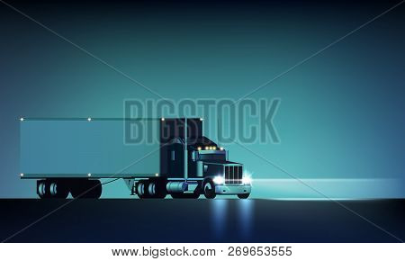 Night Large Classic Big Rig Semi Truck With Headlights And Dry Van Semi Riding On The Night Backgrou