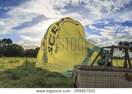 Gold Coast, Australia - November 14, 2018:  Hot Air Balloon Being Deflated By A Ground Crew Member A