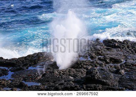 Water Bursts Through Blowhole On The Coast Of Espanola Island, Galapagos National Park, Ecuador.