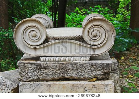 Ruins Of Ionian Style Scrollwork From The Top Of An Ancient Greek Column In The Athens Greece Nation