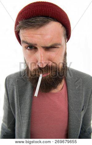 Brutal Habits And Lifestyle Of Tramp. Hipster Brutal Bearded Tobacco Smoker. Man Brutal Bearded Hips