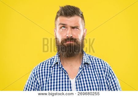 Need To Think. Man Serious Face Raising Eyebrow Not Confident. Have Some Doubts. Hipster Bearded Fac