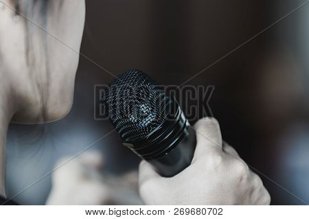 Seminar Conference Concept: Smart Businesswoman Speech And Speaking With Microphone Talking In Confe