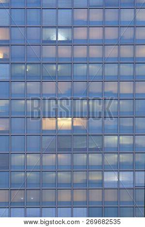 Glass Blue Square Windows Of Facade Modern City Business Building Skyscraper. Modern Apartment Build