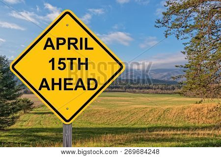 April 15th Ahead Caution Sign With Springtime Backgroumd