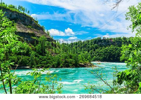 Great Amazing Gorgeous Natural Landscape View Of Niagara Falls Rushing River With Big Rocks, Cliffs