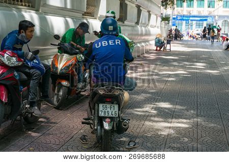 Ho Chi Minh City, Vietnam - August 24, 2017: Uber Scooter And Motorcycle Drivers Having Rest On Stre