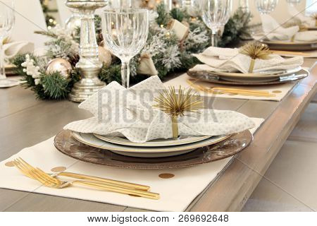 Elegant Christmas dinner table setting.