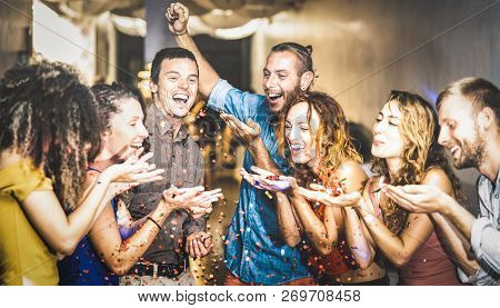 Multiracial Happy Friend Having Fun At New Year's Eve Celebration - Young People Blowing Confetti At