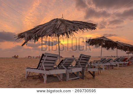 Beautiful Sunset At Goa Tropical Beach With Deck Chairs, Indian Ocean, Goa, India.