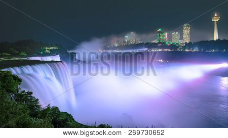 Niagara Falls Lit At Night By Colorful Lights. Niagara Falls, Ny, Usa.