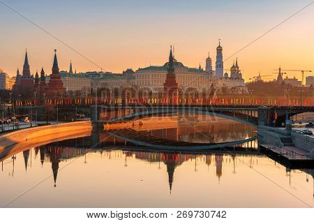 Moscow Skyline At Sunrise With Kremlin Reflection On Moscow River. Kremlin With Kremlin Wall And Tow