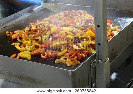 Many Yellow And Red Peppers Cooked On The Plate At A Festival