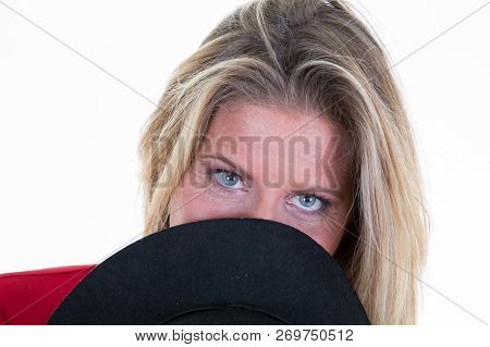Beautiful Natural Middle Age Forties Shy Blond Woman With Smiling Eyes Wearing Black Hat