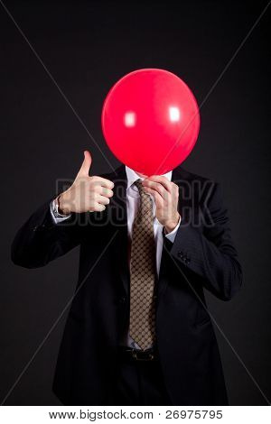 Businessman having a red balloon in the place of his head