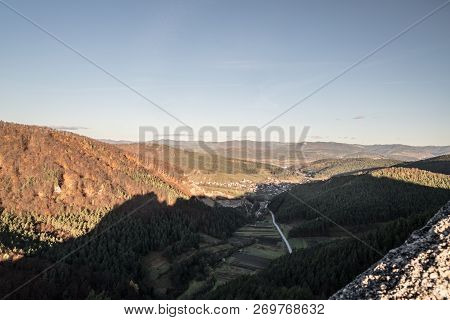View To Jablonove Village With Hills Covered By Colorful Forest Around  From Hiking Trail Near Gotic