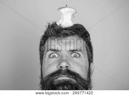 Hipster Shocked Face With Apple Stump Target On Head Blue Background, Close Up. Weight Loss Goal. Li