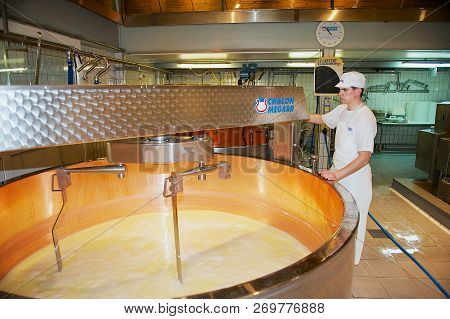 Gruyeres, Switzerland - December 11, 2009: Unidentified Worker Makes Cheese At A Cheese Factory In G
