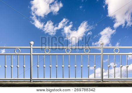 Chrome, Stainless Steel, Inox Fence Or Alu Fence. Aluminum Fence With Clouds Sky Background. 3d Illu