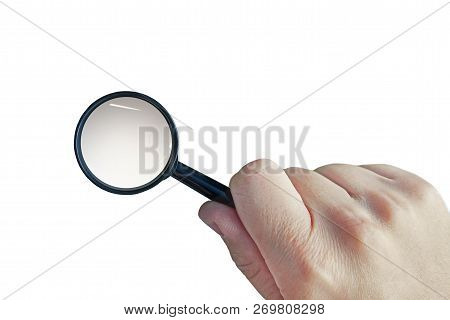 Male Hand With A Magnifying Glass Isolated On A White Background. Cutout Loupe In Mans Hand. Man Use