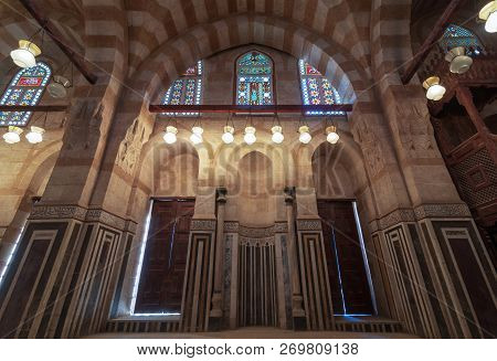 Marble Wall With Mihrab (embedded Niche), Two Wooden Doors, Huge Arches And Stained Glass Windows At