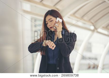 Time Out Concept.urgent Work,business Woman Seeing Wrist Watch And Using Mobile Phone Before Meeting