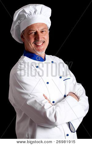 Portrait of an handsome chef isolated on black