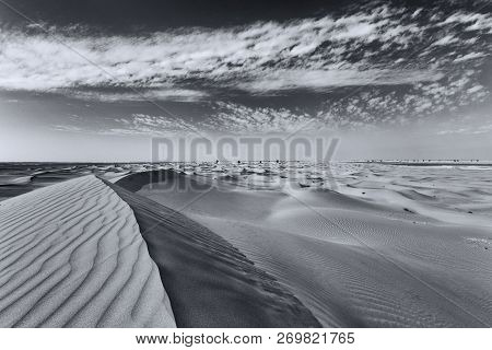Landscape Of Sand Dunes And Clouds With Wind Pattern Artistic Conversion
