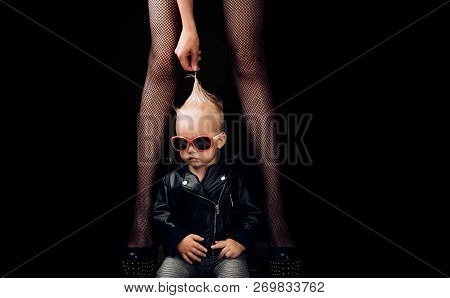 Rock Alternative. Small Boy At Female Legs. Small Child Boy In Sunglasses And Rocker Jacket. Rock St