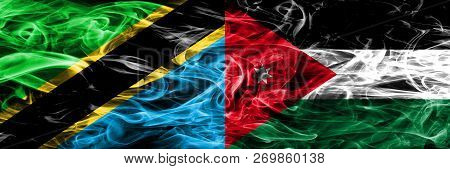 Tanzania Vs Jordan, Jordanian Smoke Flags Placed Side By Side. Thick Colored Silky Smoke Flags Of Ta