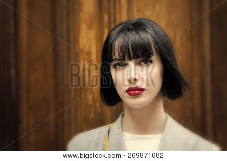 Woman With Stylish Short Brunette Hair And Red Lips. Girl Has Fashionable Makeup. Fashion Model Pose