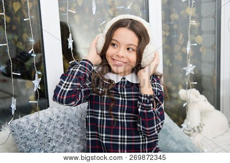 Fur Headphones Accessory. Girl Cute Child Wear Soft Furry Headphones. Warm Fashion Accessory. Winter