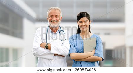 Senior And Young Doctor Working In The Hospital.