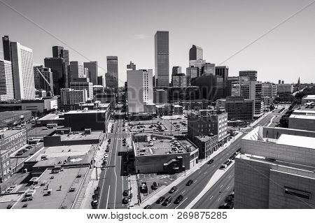 Denver , Colorado Massive Growth Of Urban Downtown Skyline Cityscape Merging Road Coming Together In
