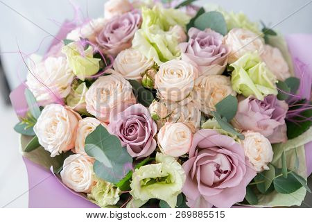 Bouquet Of Fresh Spring Flowers On Gray Wall Background. Floral Bunch In Glass Vase. Flower Shop, Fl