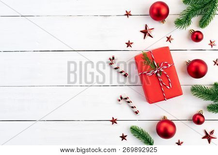 Christmas Background Concept. Top View Of Christmas Green And Red Gift Box With Spruce Branches, Pin