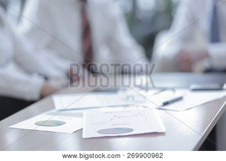 Background Image. Closeup Of A Table With Documents And Busines