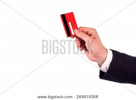 Businessmen Holding Credit Card. Hand In Black Suit Holds Out A Blank Red Credit Card. Close Up. New