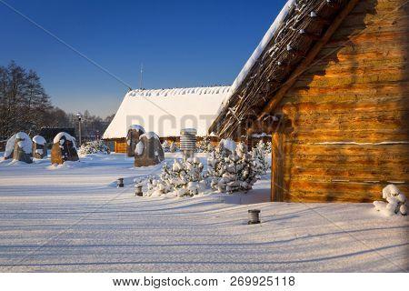 Snowy winter at medieval settlement village in Pruszcz Gdanski, Poland