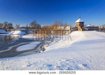 Snowy winter at historic settlement village in Pruszcz Gdanski, Poland