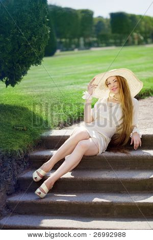 The image of a beautiful girl in a summer park