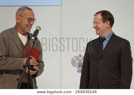 ST. PETERSBURG, RUSSIA - NOVEMBER 17, 2018: Vladimir Medinsky (right) gives the status of Russian Seasons ambassador to Andrey Konchalovsky, film director, in the last day of SPb Cultural Forum