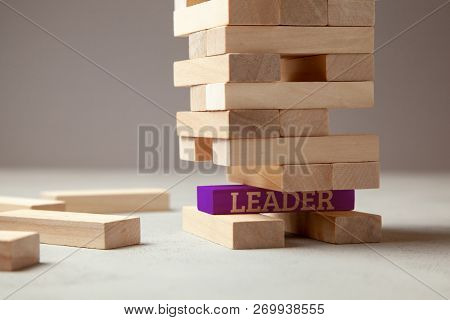 Good Leader Is Building Successful Team And Company In Business. Tower Of Wooden Blocks With The Ins